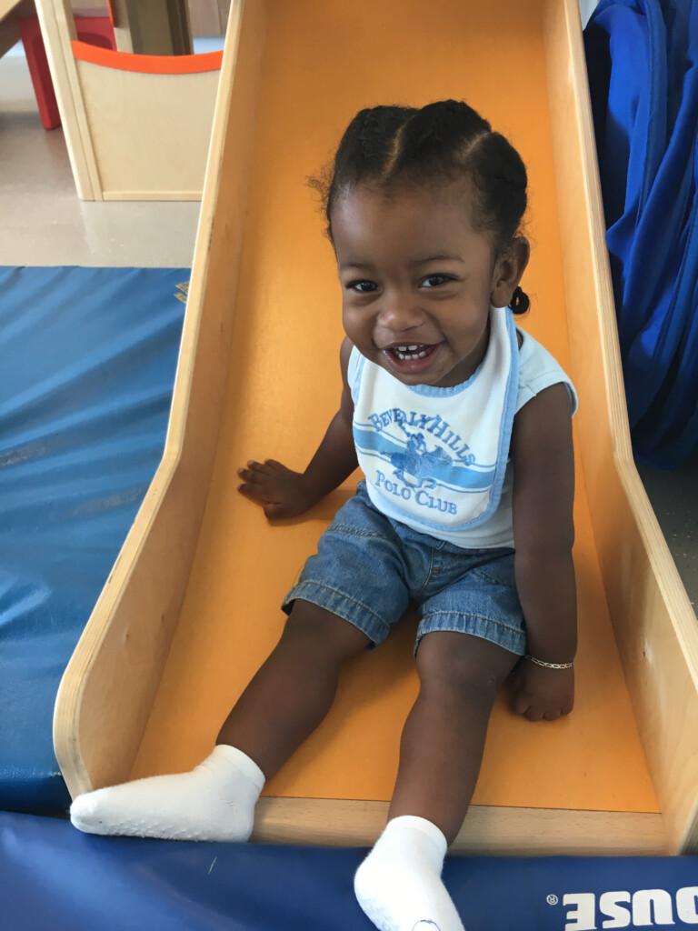 Belize: little boy on slide