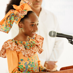 Girl at microphone presenting to an audience