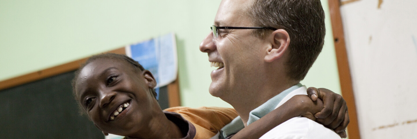Doctor holding patient laughing