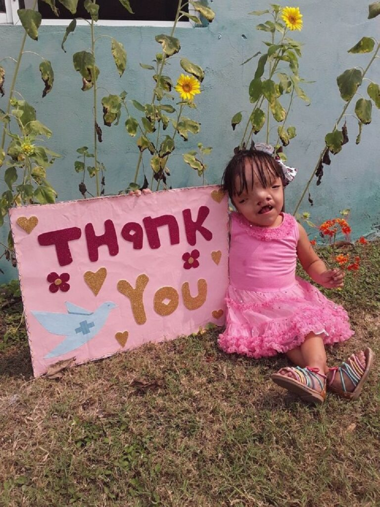 Little girl with thank you sign